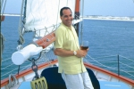 Tim Creehan enjoying a glass of wine on his boat