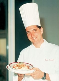 Tim Creehan in his youth, posing with a culinary creation