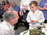 Tim Creehan speaks with a young boy aspiring to be a chef - Biography